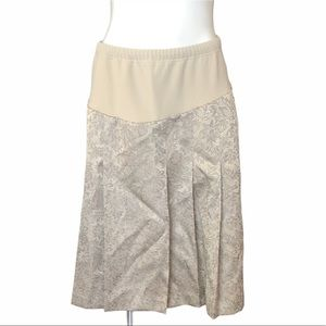 NWT Mini maternity pleaded a line cream skirt